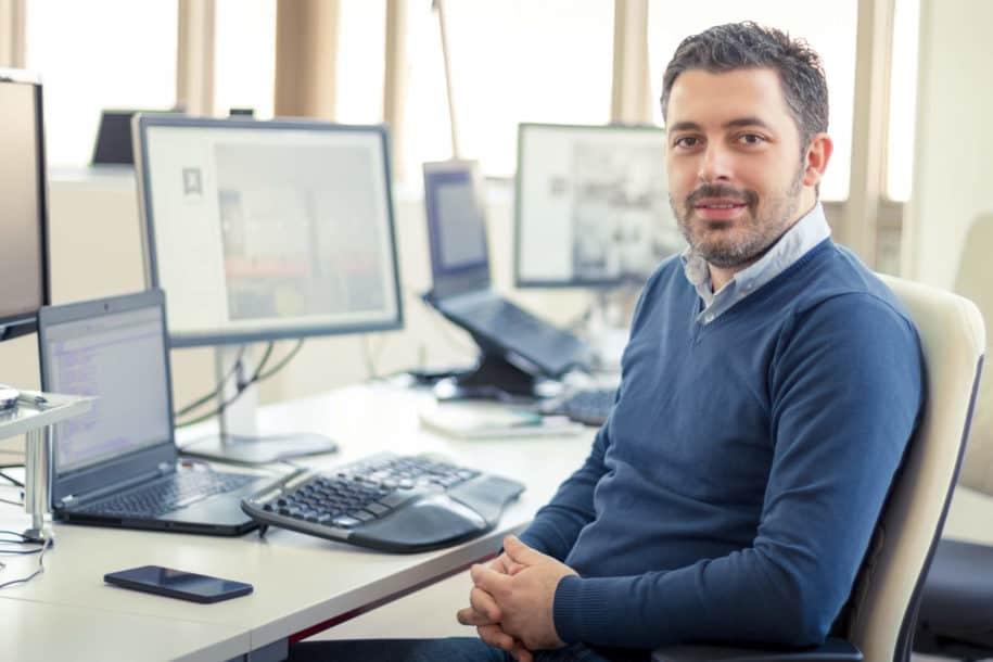 Man sitting in front of desktop computer